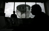Astronomers work inside the control room of the Jodrell Bank Lovell radio telescope near Macclesfield on 6 March 2008 in Cheshire England The famous...