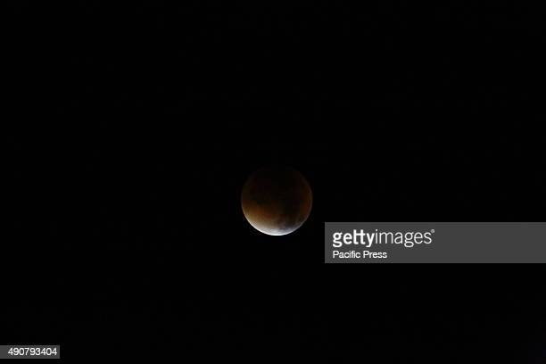 Astronomical phenomenon as the moon appeared bigger than usual in reddish hue combined with a super moon lunar eclipse This rare astronomical...