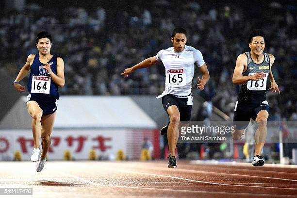 Asuka Cambridge crosses the finishing line to win the Men's 100m final ahead of Yoshihide Kiryu and Ryota Yamagata during day two of the 100th Japan...