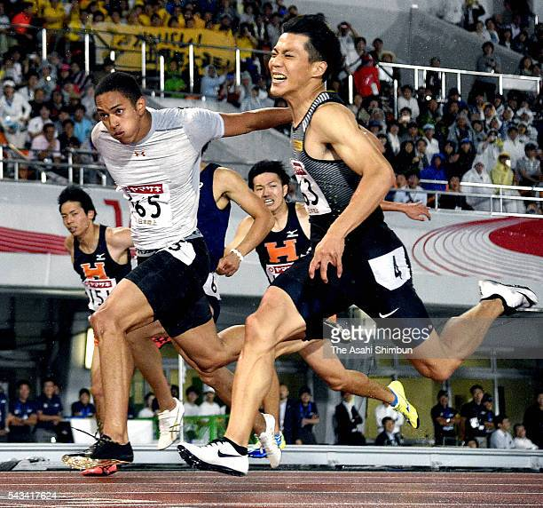 Asuka Cambrige and Ryota Yamagata cross the finishing line in the Men's 100m during day two of the 100th Japan National Athletic Championships at the...