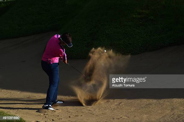 Asuka Kashiwabara of Japan hits from a bunker on the 18th hole during the third round of Japan Women's Open 2015 at the Katayamazu Golf Culb on...