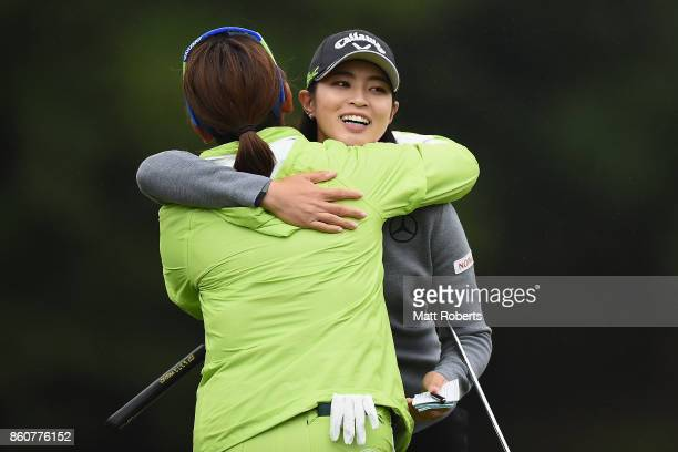 Asuka Kashiwabara of Japan hugs Yumiko Yoshida of Japan on the 18th green during the first round of the Fujitsu Ladies 2017 at the Tokyu Seven...