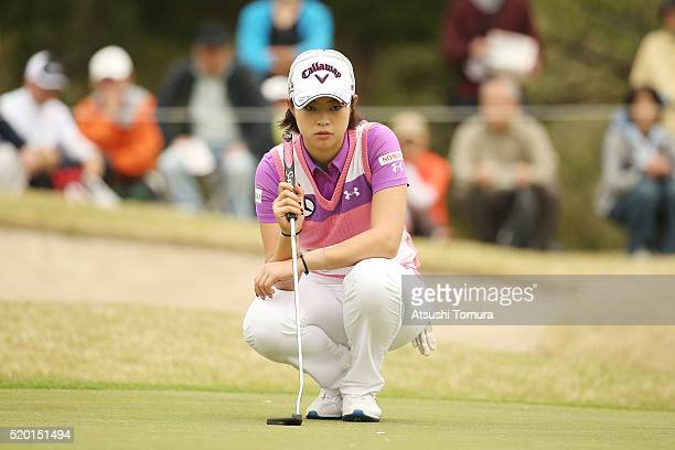 Asuka Kashiwabara of Japan lines up her birdie putt on the 16th green during the Studio Alice Open at the Hanayashiki Golf Club Yokawa Course on...
