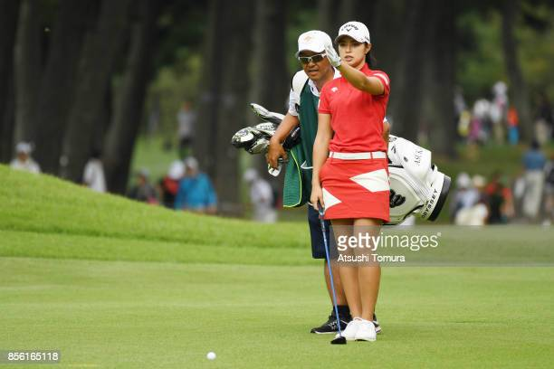 Asuka Kashiwabara of Japan lines up her second shot on the 17th hole during the final round of Japan Women's Open 2017 at the Abiko Golf Club on...