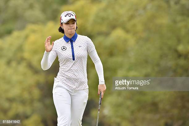 Asuka Kashiwabara of Japan reacts after making her birdie putt on the 7th green during the final round of the Yokohama Tire PRGR Ladies Cup at the...