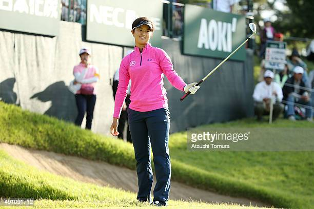 Asuka Kashiwabara of Japan reacts after missing her putt on the 18th green during the third round of Japan Women's Open 2015 at the Katayamazu Golf...