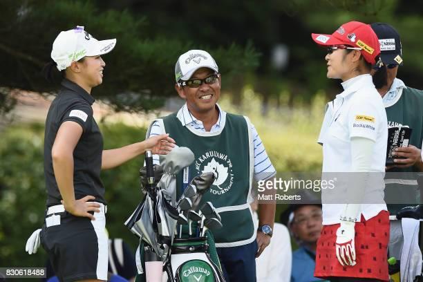 Asuka Kashiwabara of Japan shares a laugh with Saiki Fujita of Japan during the second round of the NEC Karuizawa 72 Golf Tournament 2017 at the...
