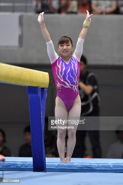 Asuka Teramoto celebrates after competing on the balance beam during Japan National Gymnastics Apparatus Championships at the Takasaki Arena on June...