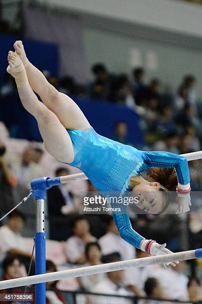 Asuka Teramoto of Japan competes in the Uneven Bars during the 68th All Japan Gymnastics Apparatus Championships on July 6 2014 in Chiba Japan