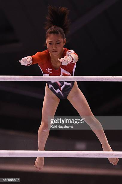 Asuka Teramoto of Japan competes in the Uneven Bars of the Women's All Around Final during Gymnastics Tokyo World Cup 2014 at Tokyo Metropolitan...