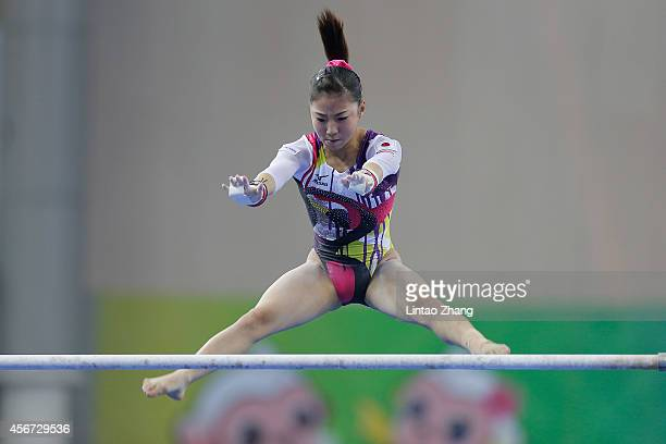 Asuka Teramoto of Japan performs on the uneven bars during the women's qualification of the 45th Artistic Gymnastics World Championships at Guangxi...