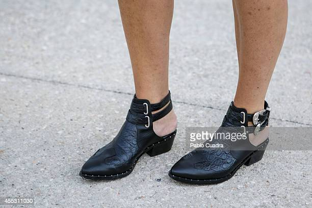 Asun wears Senso shoes ottro skirt Eleven Paris t«shirt Fornarina handbag and fossil swatch during Mercedes Benz Fashion Week Madrid at 'Ifema' on...