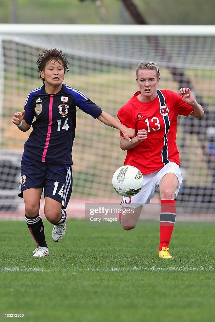 Asuna Tanaka MF of Japan challenges Gry Tofte Ims MF of Norway during the Algarve Cup match between Japan and Norway at the Complexo Desportivo Belavista on March 6, 2013 in Parchal, Portugal.