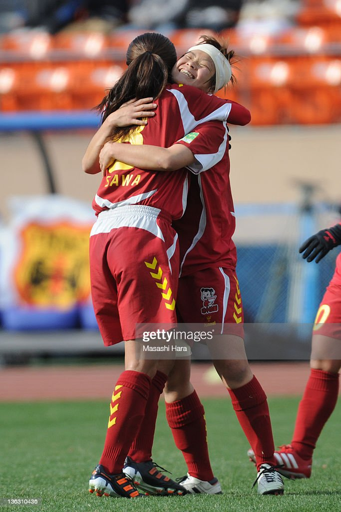 Asuna Tanaka #4 of INAC Kobe Leonessa (R) celebrates the third goal with Homare Sawa during the All Japan Women's Soccer Championship Final match between Albirex Niigata Ladies and INAC Kobe Leonessa at the National Stadium on January 1, 2012 in Tokyo, Japan.