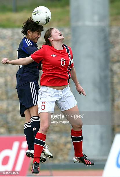 Asuna Tanaka of Japan challenges Maren Mjelde of Norway action during the Algarve Cup match between Japan and Norway at the Complexo Desportivo...