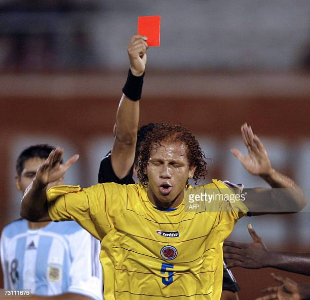 Ecuadorean referee Samuel Haro shows the red card to Colombia's Yimmy Bermudez during the South American Under20 championship soccer match against...