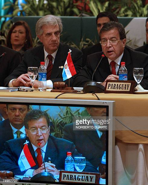 The newly assumed Mercosur President Uruguayan President Tabare Vazquez listens to his predecessor in the post Paraguayan President Nicanor Duarte...