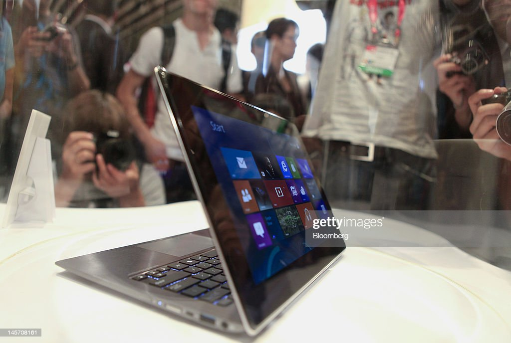 Asustek Computer Inc.'s ASUS Taichi is displayed at a news conference in Taipei, Taiwan, on Monday, June 4, 2012. Asustek today previewed a tablet using ARM Holdings Plc technology and running Microsoft Corp.'s Windows 8 operating system. Photographer: Ashley Pon/Bloomberg via Getty Images