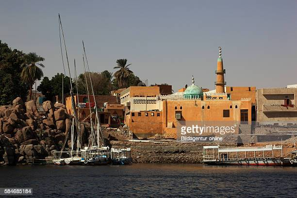 Aswan view from Nile to residential and small mosque in the city Upper Egypt Africa