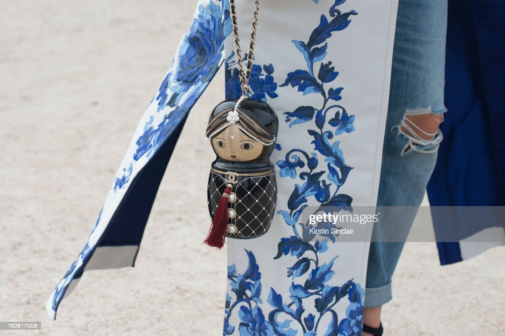 Asya Mkhytaryan wearing a Valentino jacket, H and M jeans, Chanel bag on day 8 of Paris Fashion Week Spring/Summer 2014, Paris October 01, 2013 in Paris, France.