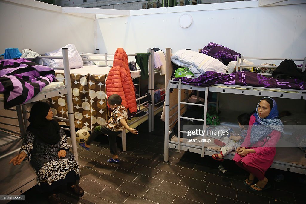 Asylum applicants from Afghanistan sit on bunk beds in the cubicle they share with other family members in Hangar 7 at former Tempelhof Airport on February 11, 2016 in Berlin, Germany. Tempelhof, once an airport in the city center and first built in the 1930s, now houses approximately 2,600 refugees in three former hangars. Berlin city authorities recently approved plans to expand its capacity to house the newcomers with an additional 90 shelters with space for 30,000 people. An estimated 50,000-80,000 migrants and refugees already live in Berlin. Germany received 1.1 million refugees and migrants in 2015 and is expecting to continue to receive large numbers in 2016.