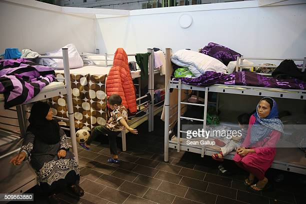 Asylum applicants from Afghanistan sit on bunk beds in the cubicle they share with other family members in Hangar 7 at former Tempelhof Airport on...