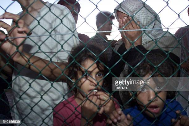 Asylum seekers both from the Tampa and Aceng arrive at Nauru off the Australian Navy troop carrier HMAS Manoora today 19 September 2001 THE AGE NEWS...