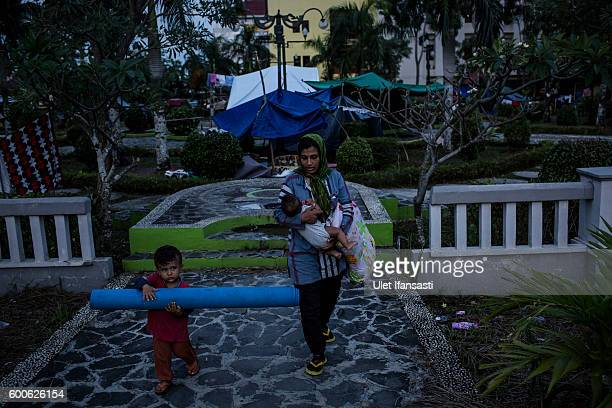 Asylum seekers from Afghanistan Farshta and her son Amir walking out of city park as they prepare to sleep in the yard area of the regional...