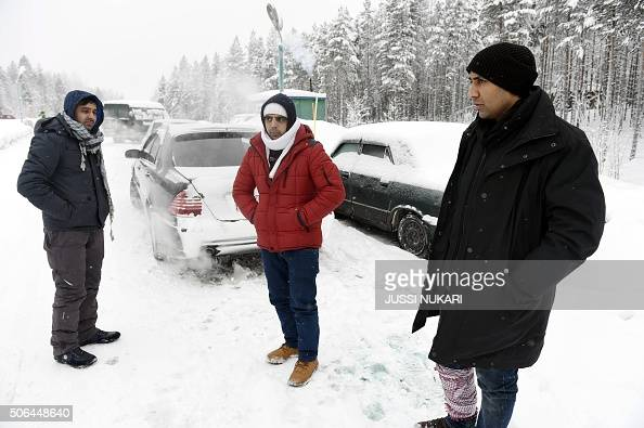 Asylum seekers Rahmatullah and Nazirulhag from Afghanistan and Fida Hussain from Pakistan wait for a permission on the Russian side of the border...