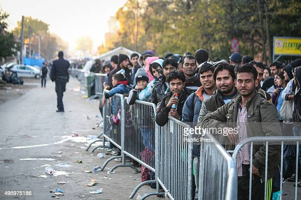 Asylum seekers wait to enter a transit camp after crossing the MacedonianSerbian border The United Nations says 210000 asylum seekers transited...