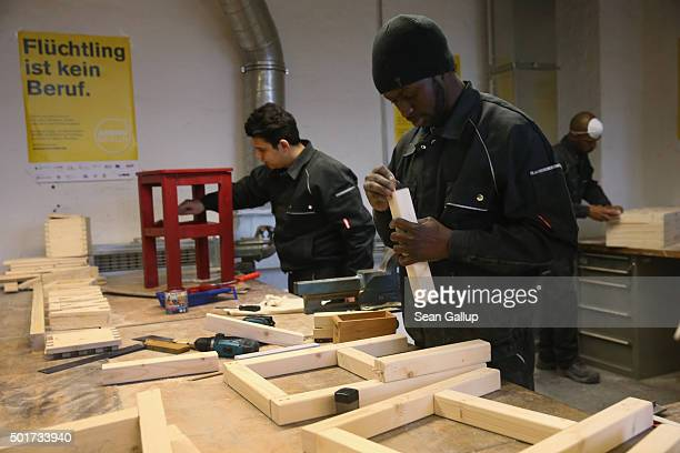 Asylumapplicants from Syria and Africa participate in the cabinetmaking tradecrafts exposure program at the Arrivo center on December 17 2015 in...