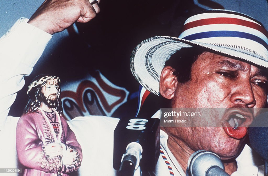 At a 1989 public rally in Santiago, a town several hours outside of Panama City, Panamanian dictator Manuel Noriega speaks harshly about U.S. involvement in Panamanian affairs, accusing the Bush administration of direct involvement in the unsuccessful coup attempt to remove him from power.