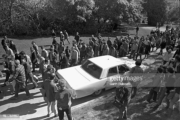 At a Black Panther demonstration marchers pass a police car on the University of California Berkeley campus Berkely California March 28 1969