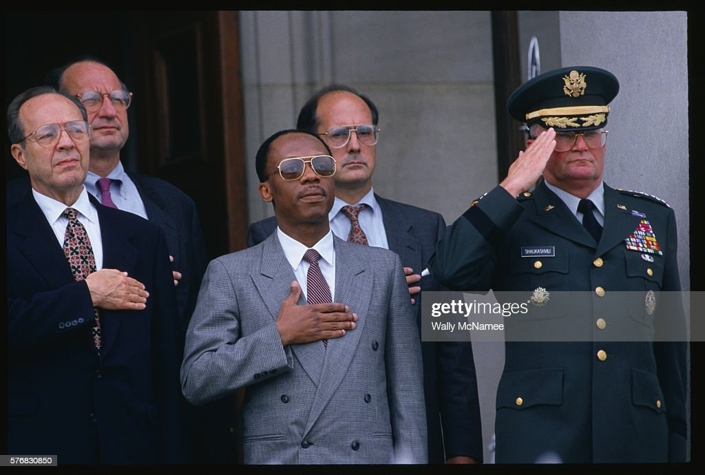 At a ceremony at the River Entrance to the Pentagon exiled Haitian leader Jean Paul Aristide is surrounded by US officials including Secretary of...