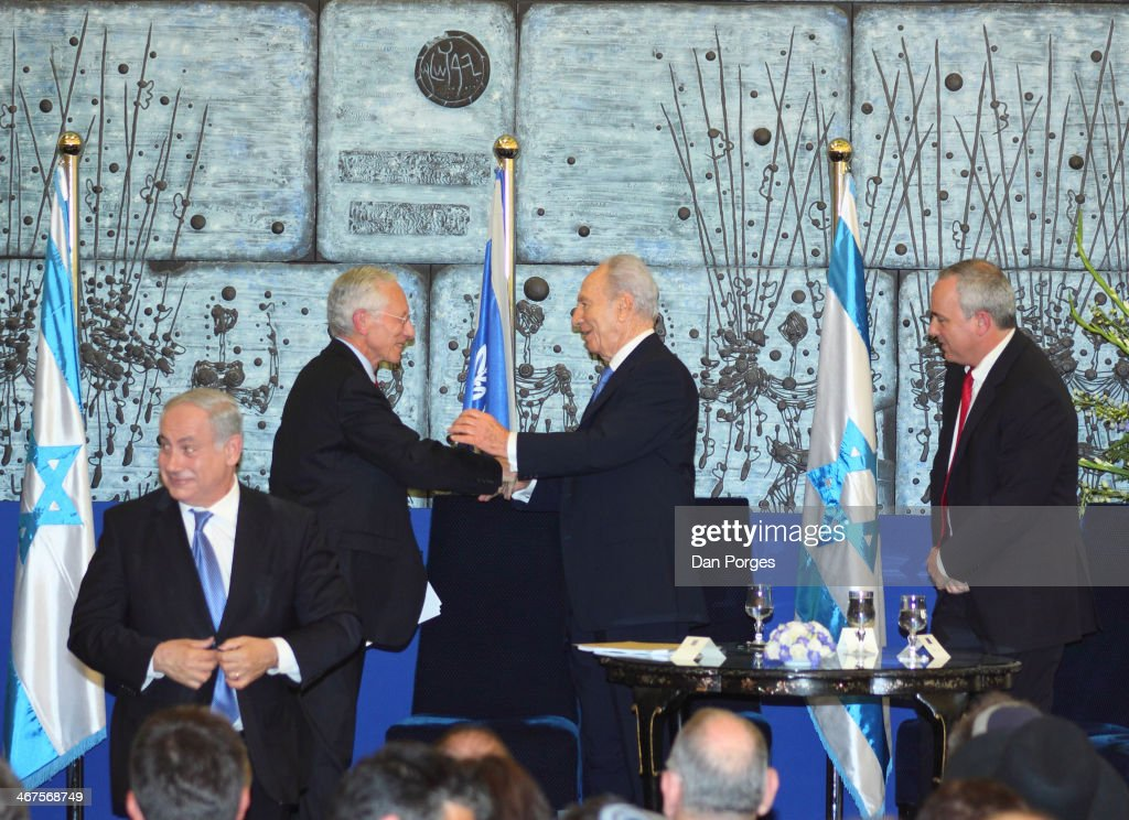 At a ceremony to re-nominate Professor Stanley Fischer (second left) to a second term as Governor of the Bank of Israel, Fischer smiles and shakes hands with Israel President Shimon Peres, as Prime Minister Benjamin Netanyahu (left), and Finance Minister Yuval Seinitz stand by, Jerusalem, Israel, May 2, 2010.