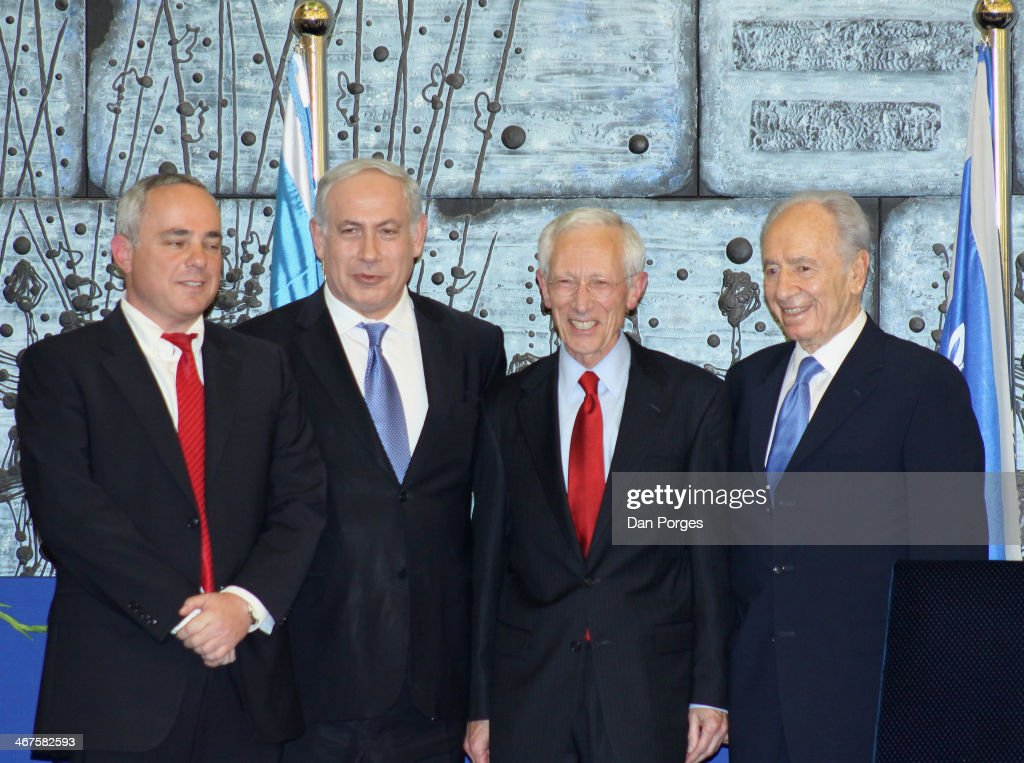 At a ceremony to re-nominate Professor <a gi-track='captionPersonalityLinkClicked' href=/galleries/search?phrase=Stanley+Fischer&family=editorial&specificpeople=233518 ng-click='$event.stopPropagation()'>Stanley Fischer</a> (second right) to a second term as Governor of the Bank of Israel, he poses with, from left, former Finance Minister of Israel Yuval Steinitz, Prime Minister Benjamin Netanyahu, and Israel President Shimon Peres, Jerusalem, Israel, May 2, 2010.