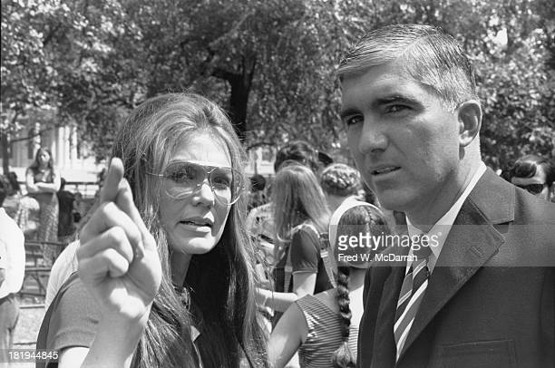 At a demonstration in City Hall Park American women's rights activist and author Gloria Steinem talks with New York Police Department Detective Jack...