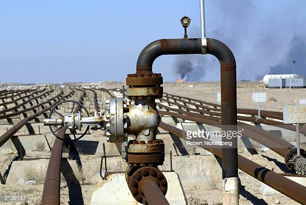At a gathering area pipes carry petroleum from medium deep wells to a refinery storage area February 6 2003 in the Ratqa Oil Field in northern Kuwait...