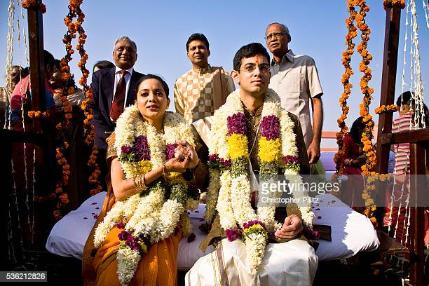 At a Hindu wedding the bride Shweta Singhal and groom Rohit clasp each others hands as they sit on a swing and take part in a ritual known as oonjal...