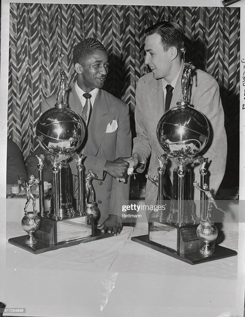 Marques Haynes and Paul Arizin with Trophies