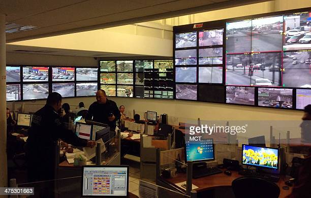 At a police command center in Culiacan Mexico staffers monitor live closed circuit television images from around the city Feb 25