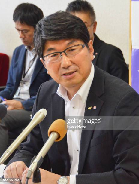 At a press conference in the southwestern Japan city of Nagasaki on Aug 25 Mayor Tomihisa Taue announces he will attend the signing ceremony of the...