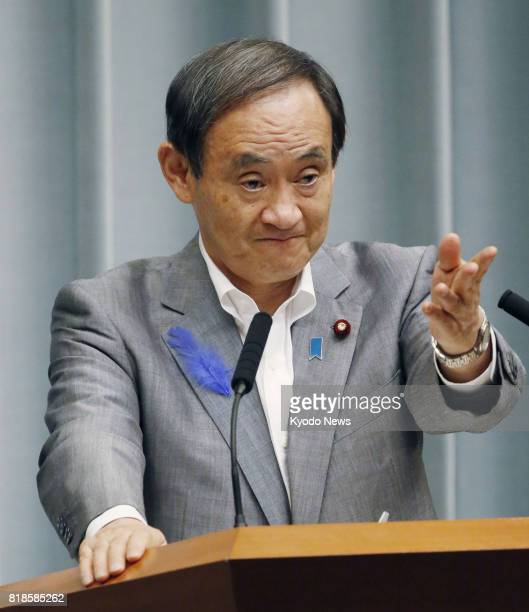 At a press conference in Tokyo on July 19 Chief Cabinet Secretary Yoshihide Suga denies a report alleging Defense Minister Tomomi Inada allowed...