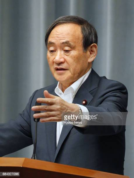 At a press conference in Tokyo on May 18 Chief Cabinet Secretary Yoshihide Suga denies allegations that Prime Minister Shinzo Abe may have been...