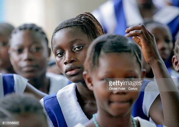 At a school in Pujehun eastern Sierra Leone students participate in an AIDS prevention campaign learning about abstinence and how to use condoms