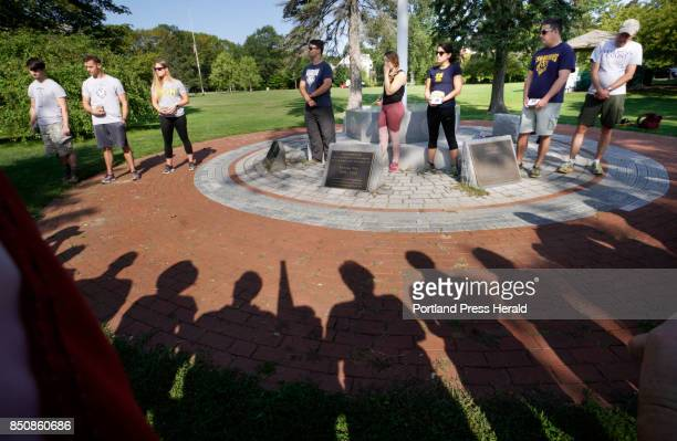 At a veterans memorial in Westbrook's Riverbank Park on Monday September 11 people participate in an event honoring deceased veterans from Maine Over...