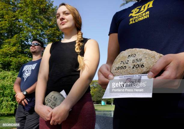 At a veterans memorial in Westbrook's Riverbank Park on Monday September 11 Salina Mallory center and Rebecca Tanous hold stones while participating...