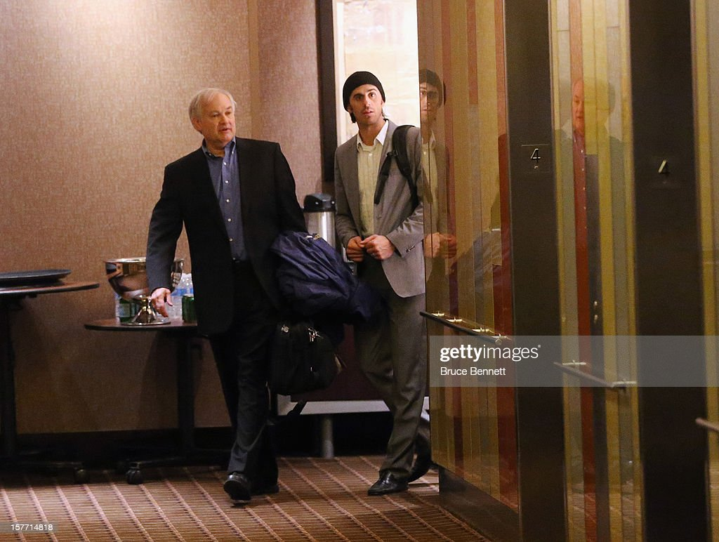 At about 1am Thursday morning NHL Players Association Executive Director Donald Fehr (L) and Ryan Miller of the Buffalo Sabres (R) leave the Westin Times Square on December 6, 2012 in New York City.