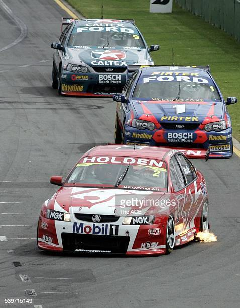 F1 GRAND PRIX at Albert Park Melbourne V8 Super cars Race 3 won by won by Mark Skaife in a Holden from Ford drivers Marcos Ambrose and Russell Ingell...