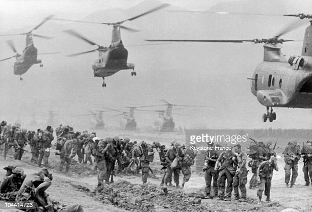 At an American military base in South Vietnam a Marine detachment troops get ready to fly to Khe Sanh where violent combats are taking place